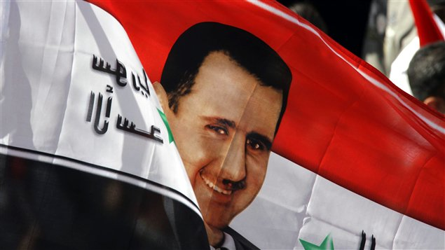Drapeau à l'effigie du président syrien, Bachar Al-Assad