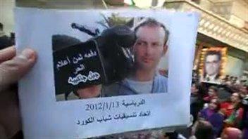 Image tirée d'une vidéo où est écrit en arabe «Gilles Jacquier, victime d'une presse libre»