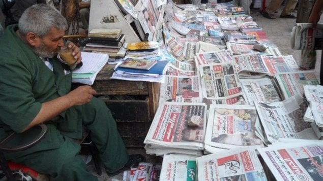 Am Ramadan, un vendeur de journaux de la place Tahrir