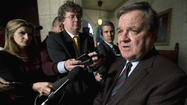 Le ministre des Finances Jim Flaherty à la sortie de la Chambre des communes à Ottawa le 3 décembre 2012.
