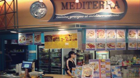 Une famille chinoise propriétaire d'un restaurant grec