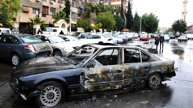 La carcasse d'une voiture piégée à Damas le 6 décembre dernier (archives)