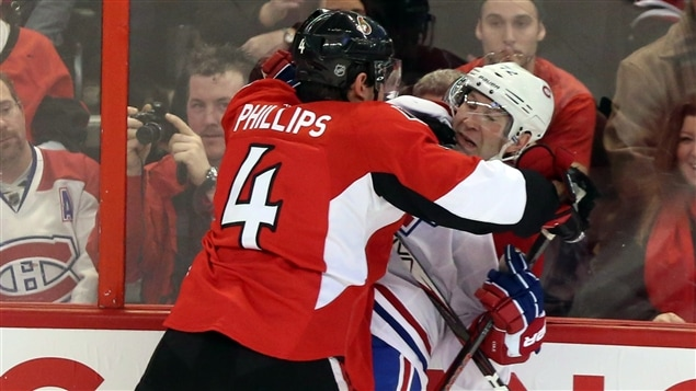 Chris Phillips (4) et Erik Cole