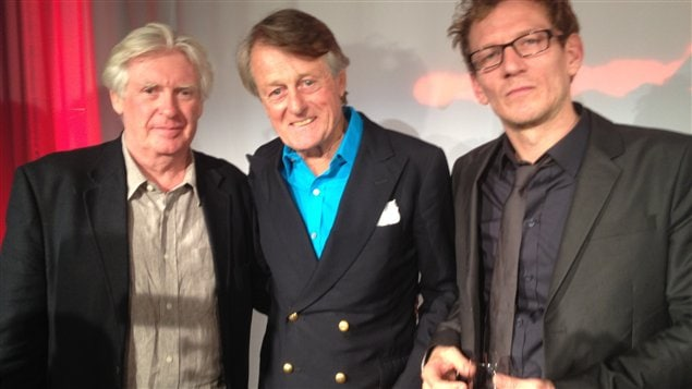 2012 Griffin Poetry Prize winners, David Harsent left, and Ken Babstock right, flank Scott Griffin who established one of the world's most generous prizes for Canadian and international poetry