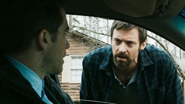 Jake Gyllenhaal et Hugh Jackman dans une scène de du film Prisoners.