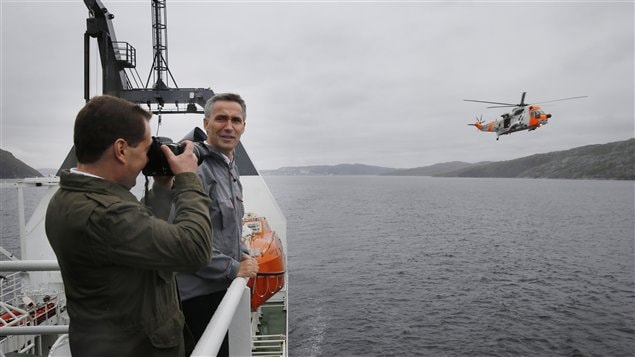 Russia's Prime minister Dmitrij Medvedev (L) and Norway's Prime minister Jens Stoltenberg attend a rescue exercise at the research vessel Helmer Hanssen during the Barents Euroarctic council meeting in Kirkenes, Norway on June 4, 2013.
