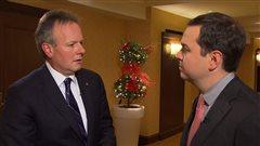 Stephen Poloz, gouverneur de la Banque du Canada, et Gérald Fillion, à droite