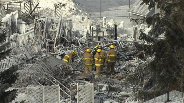Des pompiers sur les lieux du drame.
