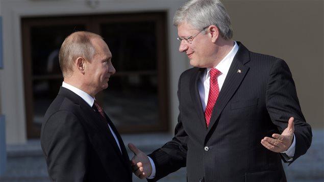 Vladimir Poutine (gauche) et Stephen Harper (droite) lors du sommet du G-20, le 5 septembre 2013
