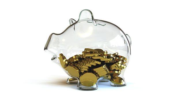 Des pièces de monnaie dans une tirelire vide