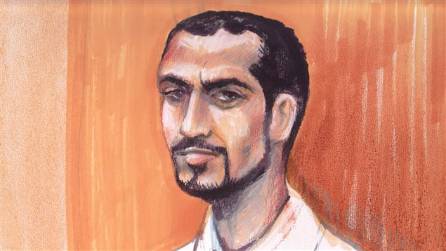 Omar Khadr as he appeared in an Edmonton courtroom 2013 in this artist's sketch.  Khadr has made a request to speak with the Canadian media. Khadr has close cropped black hair that is beginning to recede. He has a slim beard, mustache and goatee. He has a Roman nose and prominent eyebrows. He has a serious look on his face and is wearing a white shirt.