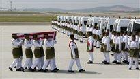 Arrivée des premiers corps de victimes malaisiennes du vol MH17 à Kuala Lumpur