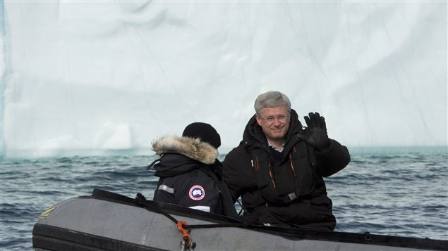 Prime Minister Stephen Harper and his wife, Laureen, take a closer look at an iceberg in a Zodiac inflatable boat Sunday west of Pond Inlet on Eclipse Sound.