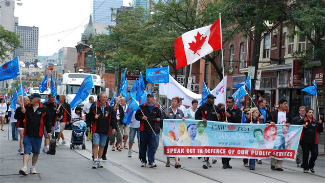 File photo of Toronto's 2011 Labour Day Parade. It's one of the largest of the many under way across the country today.