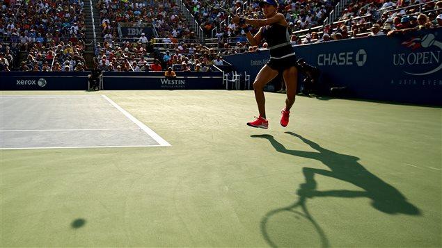 لاعبة كرة المضرب الكنديّة اوجيني بوشار واجهت  اللاعبة الروسيّة أكاترينا ماكاروفا في بطولة فلاشينغ ميدوز  الأميركيّة في 1 أيلول سبتمبر 2014