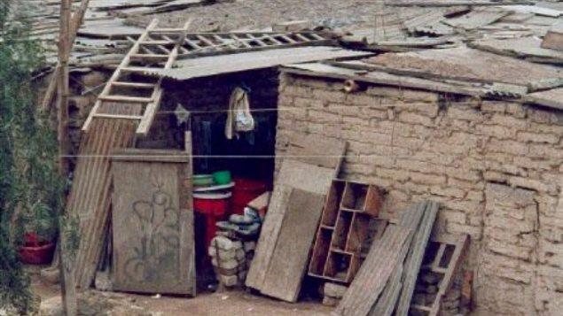 Vivienda en un barrio marginal en Honduras. La pobreza es una de las causas de las actividades pandilleras.