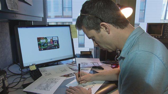 Philippe Girard sur sa table à dessin