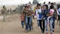 L'État islamique fait reculer les Kurdes, la Turquie se prépare