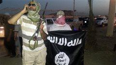 Des militants de l'organisation armée État islamique en Irak, en juin.
