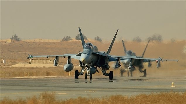 Canadian CF-18 fighter jets prepare to take off from a base in Kuwait. Canadian CF-18 Hornets have been based in Kuwait as part of Operation Impact since October 2014. Their combat mission will end by Feb. 22, 2016.