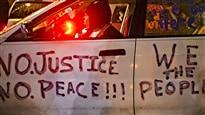 Ferguson : trois arrestations en attendant la décision du grand jury