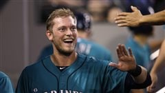 Michael Saunders, a Mariner last season, has been given the left field job in Toronto. The Jays hope he playing at Rogers Centre will increase his power numbers. Saunders is walking through the dugout slapping five, wearing the teal-based white-scripted