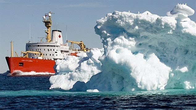 The Canadian Coast Guard icebreaker Louis St. Laurent sails past a iceberg in Lancaster Sound in July 2008.