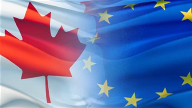 العلمان الكندي والأوروبي رمز للتعاون بين كندا والاتحاد الأوروبي