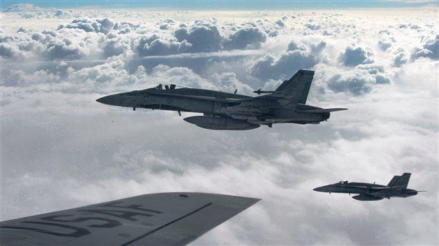Des CF-18 de la Royal Canadian Air Force se dirigent vers l'Irak.