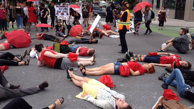 Demonstrators protest the Harper government's proposed prostitution legislation on a Toronto street, June 14, 2014