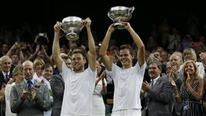 Vasek Pospisil, right, and Jack Sock of the U.S hold up their trophies winning the men's doubles final at Wimbledon last July. Can they recapture their magic in Paris? Each, of course, is dressed in their all-white shirts and shorts (it was Wimbledon, after all). Both are young and blond and look very, very fit. Each holds a winner's trophy cup above his head and are sporting big smiles.