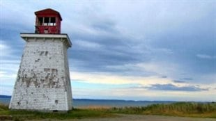 The Church Point lighthouse, which was built in 1874, as it was before its complete destruction in the storm.