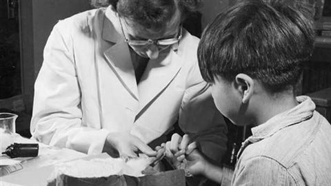A nurse takes a blood sample from a boy at the Indian School in Port Alberni, B.C., in 1948, during a period when nutritional experiments were being conducted on some 1,300 aboriginal children. To study disease and nutrition,Subjects were kept on low food diets, and given or denied vitamins, minerals and certain foods. Some dental services were also withheld because researchers thought healthier teeth and gu Documents show these experiments were approved by a House of Commons committee.