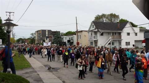 Thousands of marchers walk through Ottawa to mark the final event of the Truth and Reconciliation Commission Sunday.