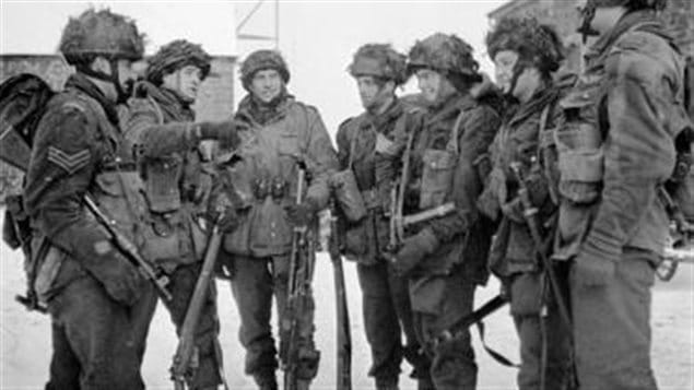 Paratroopers of the 1st Canadian Parachute Battalion preparing for a patrol, Bande, Belgium, 15 January 1945.  They carry a mix of weapons from the Tommy gun (left), the standard Lee-Enfield No4 rifle (next) to the Bren LMG (next) to the Sten (3rd from right)