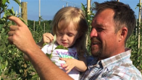 David Knight, right, with his daughter Scarlett, left. Knight has used Semios's system for the past two seasons as part of a regulatory trial.