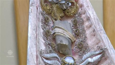 Another of the reliquaries found in the attic of the New Brunswick home, which apparently countains a relic of a bone fragment, possibly of some ancient Saint.