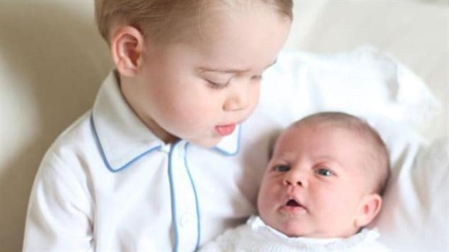 A recent photo of Prince George holding Princess Charlotte released by Kensington Palace. If she had been born first she was to be Queen with a change of law.  Now a challenge from Canada puts the Line of Succession into question.