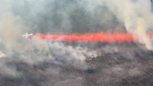 A forest fire about 23 kilometres north of Stewart Crossing, Yukon, is being fought from the air and on the ground.