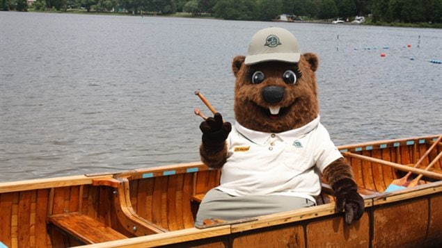 """The Parks Canada mascot """"Parka the beaver"""" in a traditional birchbark canoe. Though most Canadians live in urban settings  a majority say they have seen beavers in the wild, and they have been in canoes"""