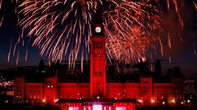 A June survey showed 71% of Canadians say they plan to celebrate the national Canada Day holiday today. Many of them say they'll take in a fireworks display, Here the fireworks shown highlighting the Centre Block of Parliament in the national capital, Ottawa. Surveys also show however that Canadians have a slim grasp of their own history.