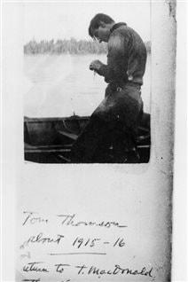 Tom Thomson on Canoe Lake preparing fishing equipment 1915-or 16