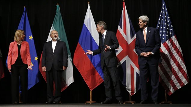 Iran's Foreign Minister Mohammad Javad Zarif (2nd from left) with British Foreign Secretary Philip Hammond, 2nd right, U.S. Secretary of State John Kerry, right, and European Union High Representative for Foreign Affairs and Security Policy, Federica Mogherini, wait for Russian Foreign Minister Sergey Lavrov, for a group picture today at the Vienna International Center in Vienna, Austria