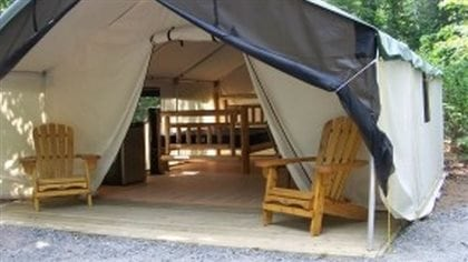 Glamping provides a few more of the comforts of home, like a bed and a floor and a rood over one's head, while still taking you into the great outdoors.