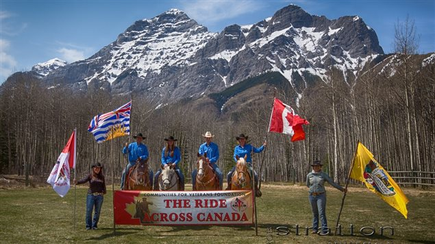 Paul Nichols and family In British Columbia with the Rocky Mountains in the background prior to the ride across the country. The ride will be arriving in Ontario in late july or early August