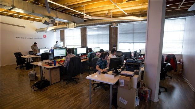 Employees at work at Bazinga! in Vancouver, British Columbia on August 13, 2014. The company offers a cloud-based platform for online interaction between residents in condo buildings and property management and developers