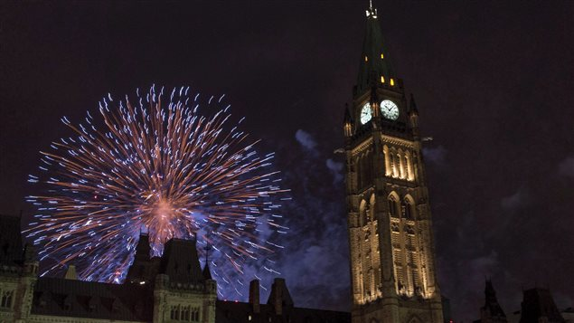 Fireworks explode behind the Peace Tower on Parliament Hill during Canada Day celebrations on July 1, 2015 in Ottawa.