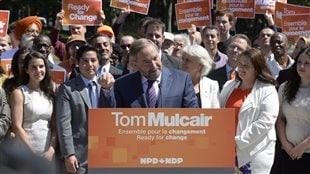 Mulcair défend le bilan du NPD et attaque Harper sur le front économique