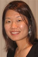 Dr. Maria Chiu led the study that uncovered varying health trends for members of different ethnic groups. She is facing the camera in what appears to be a black evening dress. She wear large, silver earings and a lovely smile below her dark, penetrating eyes and shoulder-length brown hair.