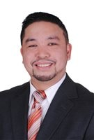 NDP candidate Mario Jacinto Rimbao. He has a lovely smile and a goatee and is dressed in a classy dark suit and tie.